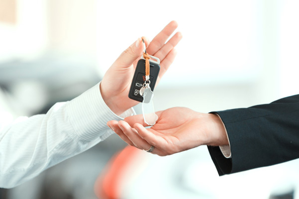 Image of keys being handed over