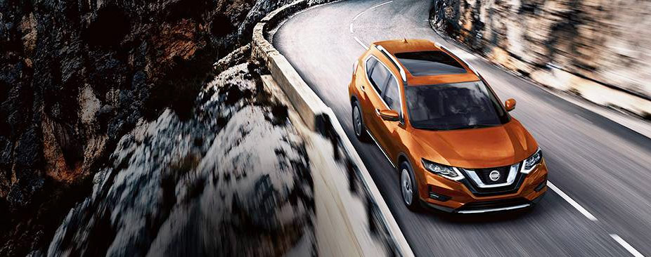 Nissan Rogue SL shown in Monarch Orange with optional equipment